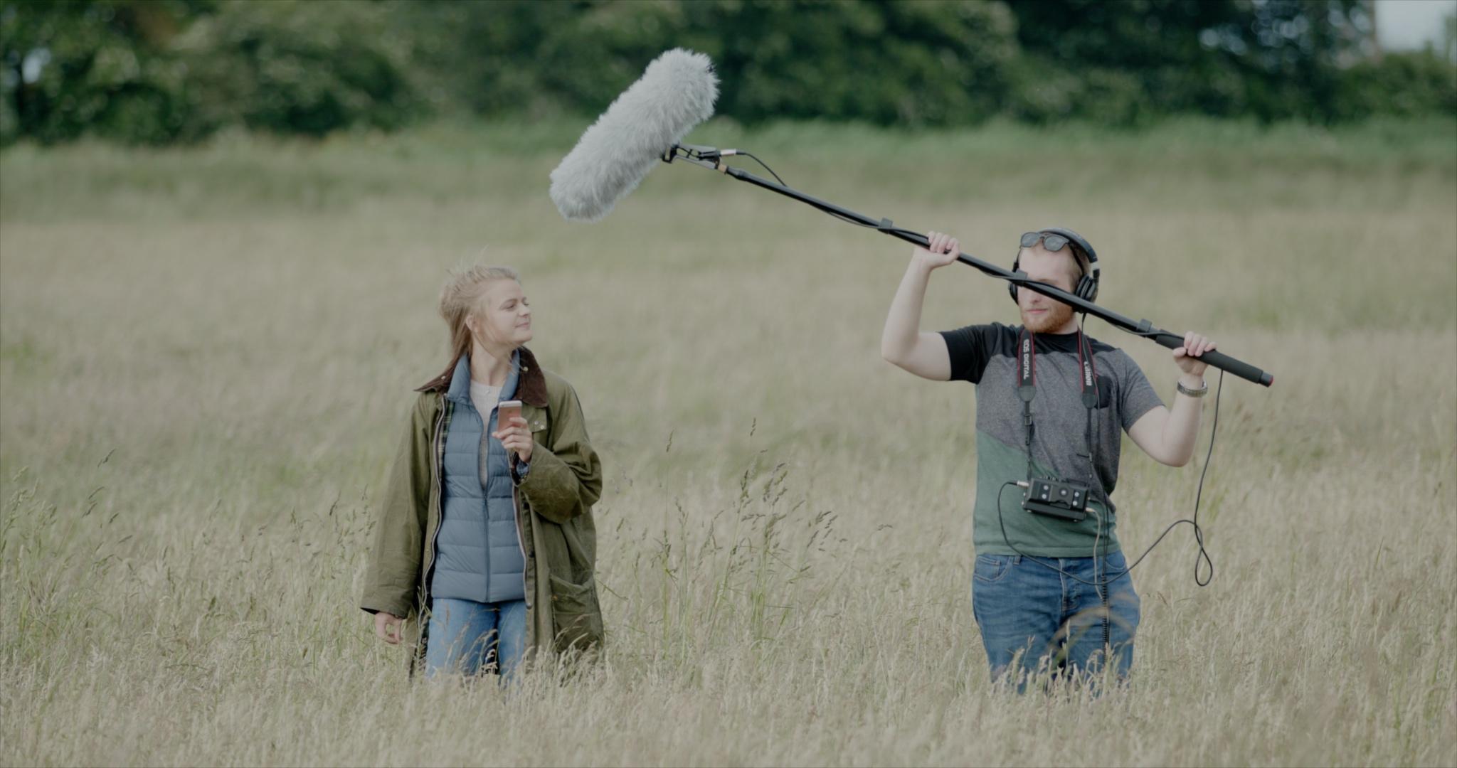 Sound recordist Peter Baumann capturing location audio for The Carbon Farmer